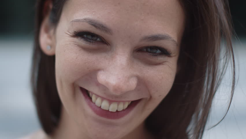 Portrait of Attractive Smiling Caucasian Ethnicity Young Woman in Urban Environment. Shot on RED Cinema Camera in 4K (UHD). | Shutterstock HD Video #19367230