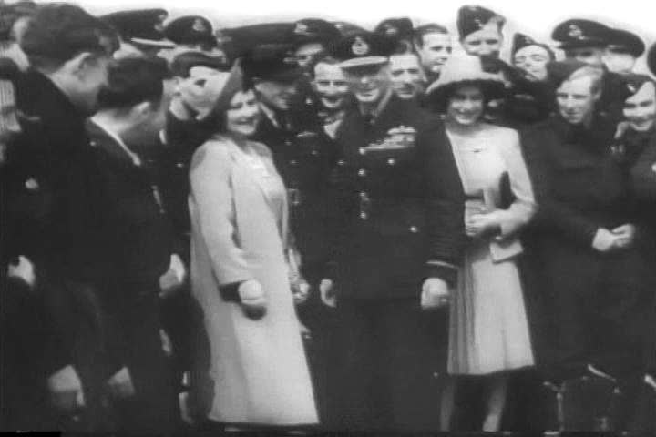 King George VI and Queen Elizabeth visit British and American air bases in 1944; the Queen christens a bomber. (1940s)