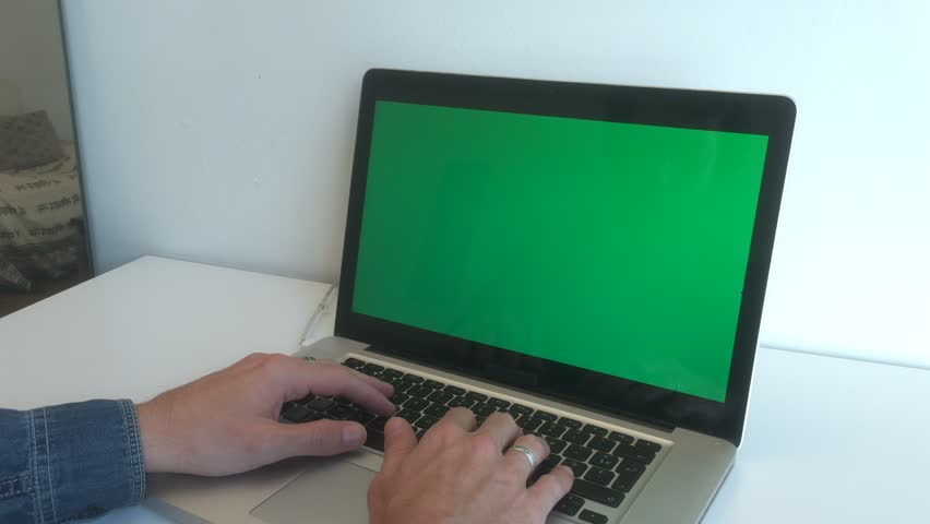 Man Typing And Surfing Internet On Green Screened Laptop. Male hands typing on a green screen laptop on the desk. Ungraded 4k | Shutterstock HD Video #19430932