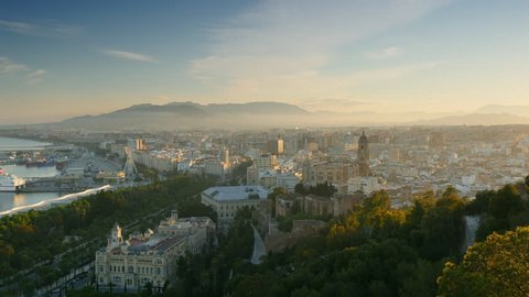 Cityscape aerial view of Malaga, Spain. Panning shot. UHD, 4K