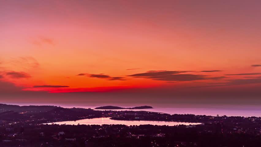 Spectacular sunrises over sea and lake on a tropical island. 4K time lapse