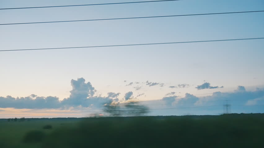 view from moving train on TRANS-Siberian railway at sunset
