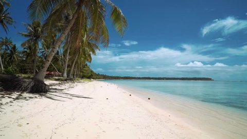 Moving forward on white sand beach on tropical island, Siargao Island, Philippines