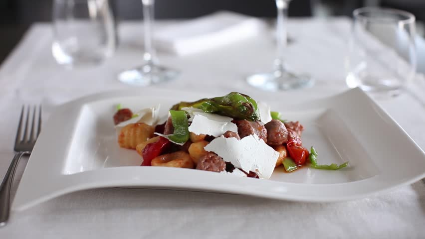 Gnocchi with sausage and vegetables. 360 rotation food