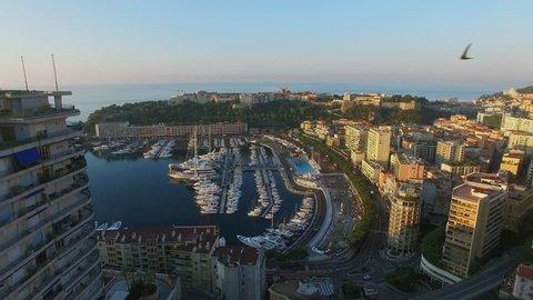 Monte Carlo, Monaco,Townscape with Port Hercule, Monaco-Ville commune and La Condamine quarter at summer evening during sunset. Aerial view