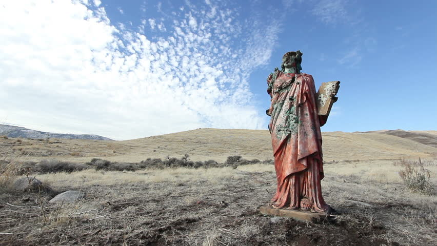 A grungy religious statue in the middle of nowhere.   Shutterstock HD Video #1955512