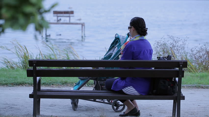 Video Bench Part - 45: Mother Go Out Bench With Baby In Stroller Near Lake - HD Stock Video Clip