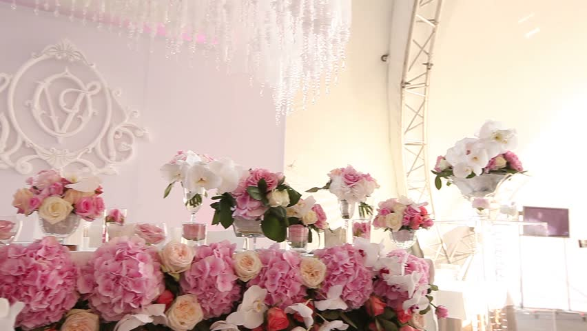 wedding table  decoration with flowers, flower decoration wedding table, wedding florist, wedding at the table is Pano  with letters and monograms, rose flowers and  white orchid