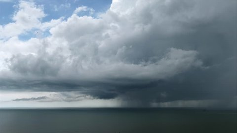 Cloudscape and rainstorm over the Pacific Ocean in Panama. Bad weather with clouded sky, rain, thunders. Sea waters, winds, climate change, tropical storm with bolt. Tornado, twister. Time-lapse