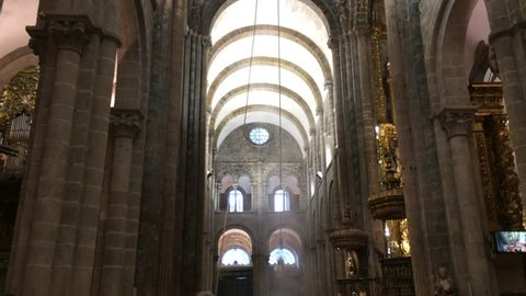 SANTIAGO DE COMPOSTELA, LA CORUNA - SEPTEMBER 1, 2016: Botafumeiro swinging on the Cathedral of Santiago de Compostela, Camino de Santiago, Galicia, Spain.