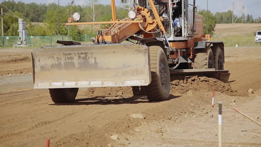 Grader on construction of new roads   Shutterstock HD Video #19688062