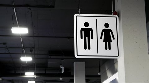Motion of man and woman washroom logo beside wall with 4k resolution