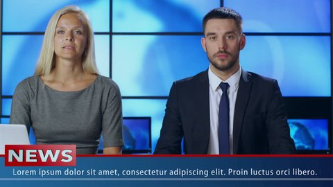 Two News Presenter in Broadcasting Studio. Shot on RED Cinema Camera in 4K (UHD).