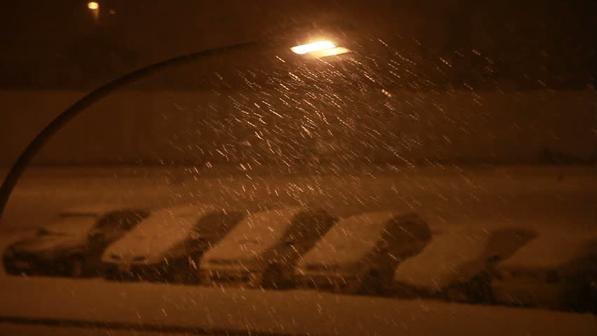Cars under the snow at night