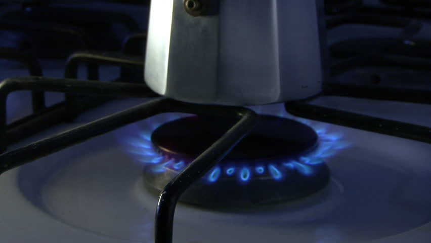 Gas flames in the stove with coffee maker