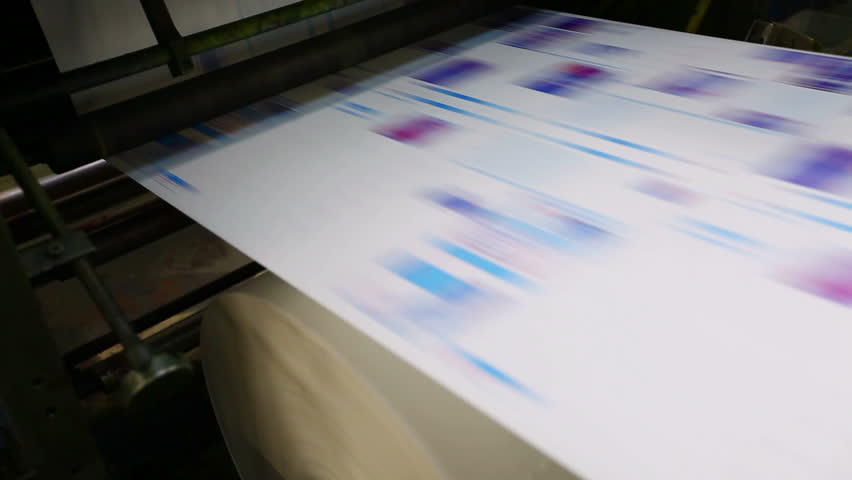 pan on print press typography machine in work