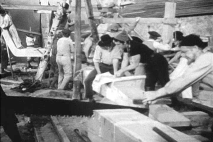 Early American colonists build a ship in the 1700s (as depicted in 1960). (1960s)