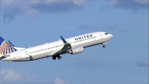 United Airlines plane taking off - Logan Airport, Boston USA - August 12, 2014