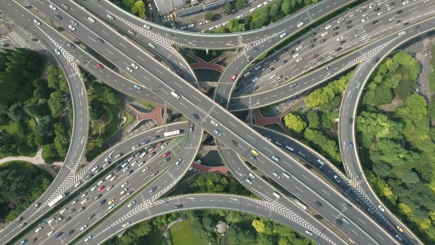 Abstract aerial drone shot of traffic driving over the beautiful Yan'an elevated highway, a busy intersection and convergence of roads in Shanghai city, urban China.
