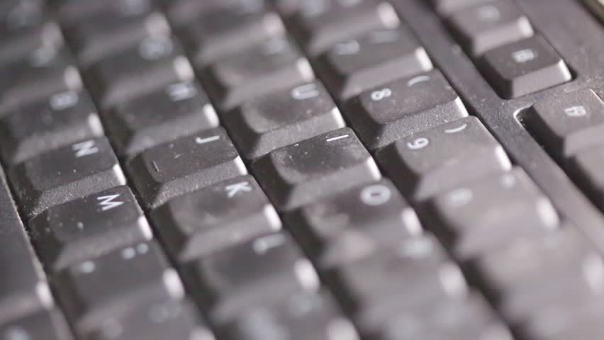 italy blur abstract finger tiping a code in keyboard with noise and dirty real work background  | Shutterstock HD Video #19837822