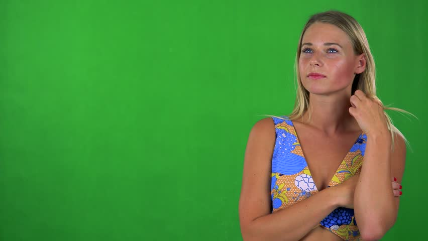 Young pretty blond woman thinks about something - green screen - studio    Shutterstock HD Video #19848472