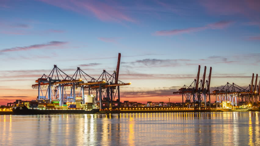 HAMBURG, GERMANY  September 9, 2016: Harbor container ship terminal in evening timelapse Illuminated Hamburg container terminal with clouds on a sky time lapse | Shutterstock HD Video #19854262