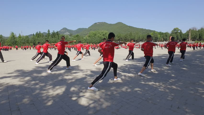 SHAOLIN, CHINA - MAY 2016: Martial arts students practice at the training grounds of a large institute in Wushu, the 'birthplace' of kung fu in central China