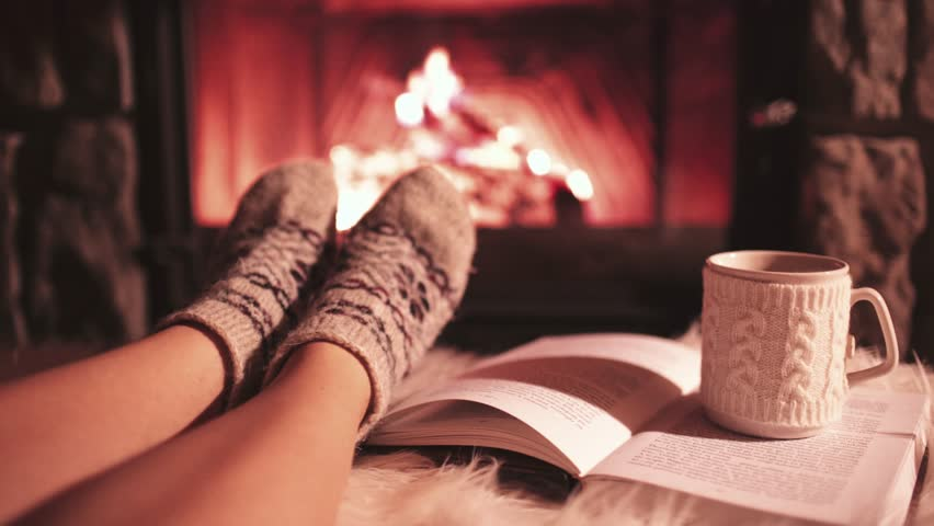 Image result for girl by fireplace with tea and a book