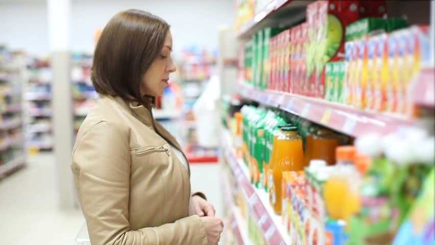 Woman buys juice | Shutterstock HD Video #19954828