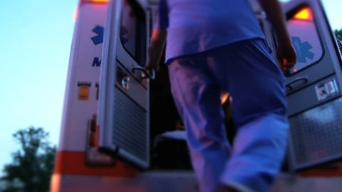 Emergency medical worker in hospital ambulance