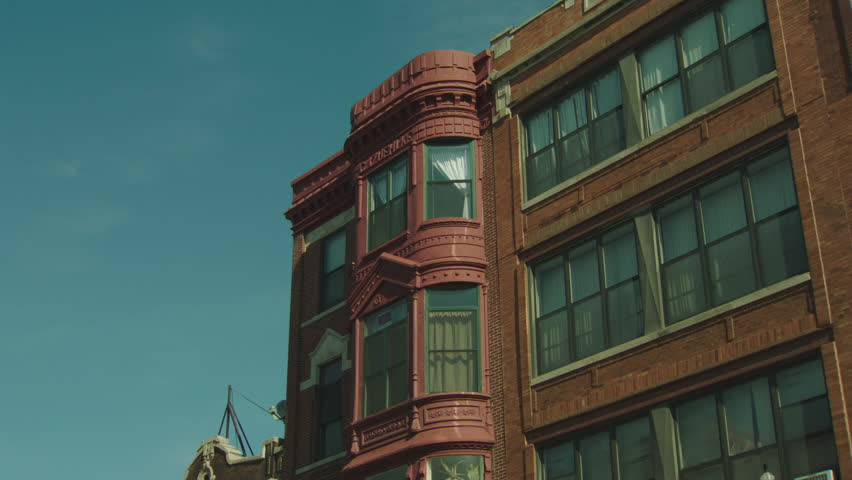 Brick Apartment Building Window night hold up 2nd 3rd floor windows quaint brick building office