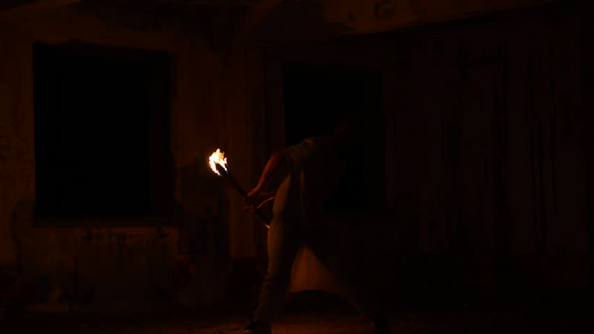 man juggling fire