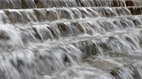 Close shot on big beautiful waterfall fountaine. Background