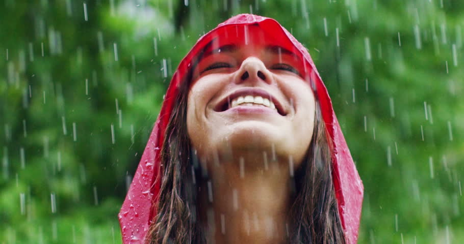A happy woman smiles in the rain, the woman immersed in the nature of dance under the happy and free rain in slow motion. Concept of love, nature, happiness, freedom. | Shutterstock HD Video #20072242