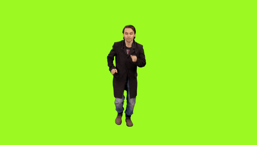 A man in a coat and jeans running and looking at his watch, Full HD shot with alpha channel