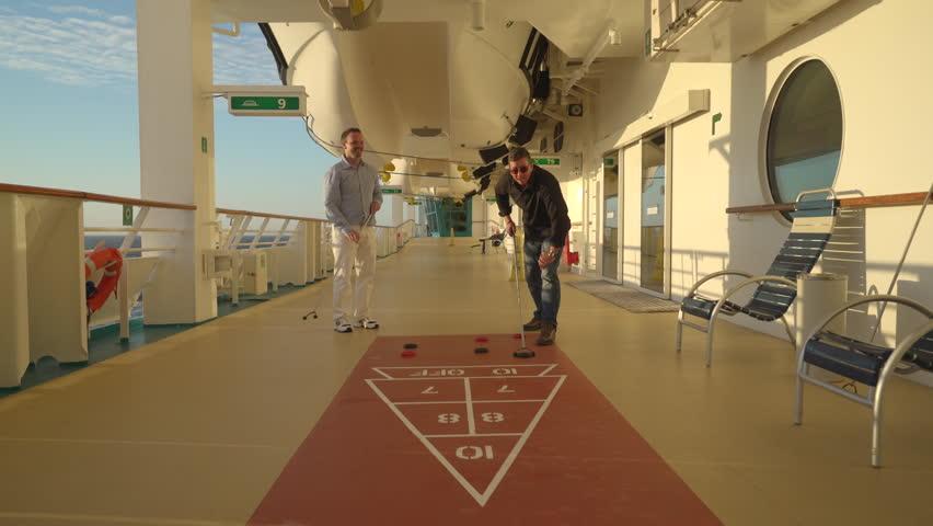 Shuffle Board On Recreation Deck Cruise Ship Passengers