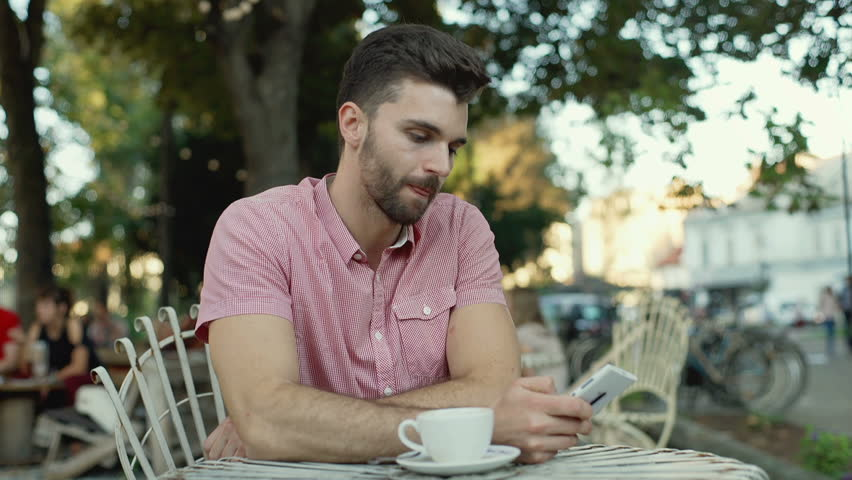 Irritated finish drinking coffee while checking time and leaving outdoor cafe  | Shutterstock HD Video #20098402