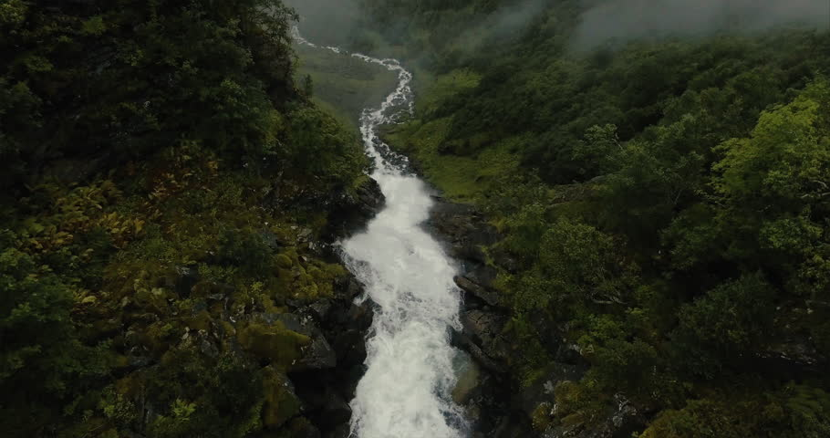 Dramatic reveal of a huge mountain waterfall located near Geiranger Fjord, Norway #20119162