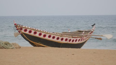 Puri,India - March 02,2016: Traditional painted boat on beach