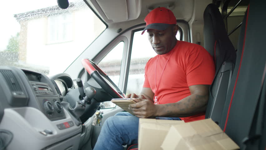 Stock video of 4K Delivery Driver Checking Packages In Van Then ...