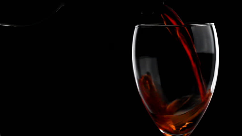 e6eb47d1290c hd00 16Red wine poured into glass isolated on black background