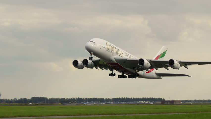 SCHIPHOL AIRPORT AMSTERDAM - CA SEPTEMBER 2016: Emirates A380 largest passenger airplane in the world takeoff with ambient audio