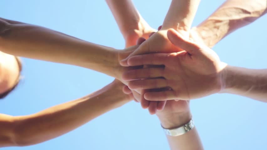 Successful team: many hands holding together on sky background in slowmotion. 1920x1080 | Shutterstock Video #20240938