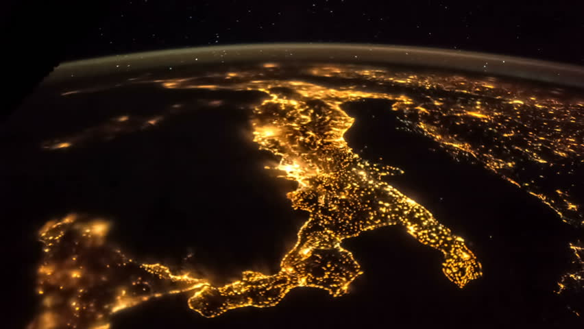 Planet Earth at night seen from the the International Space Station ISS. Italy lit night lights. Beautiful Planet Earth observed from space. Elements of this video furnished by NASA.