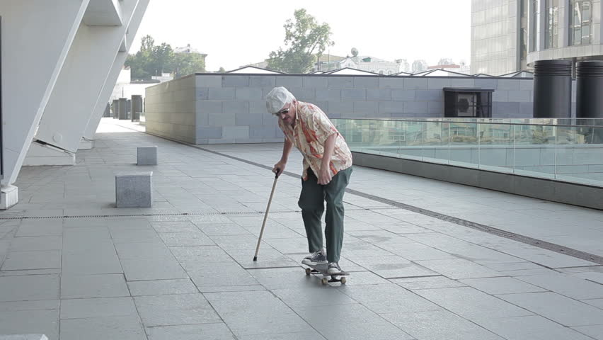 Old man with a walking stick falls from the skateboard. | Shutterstock HD Video #20348242