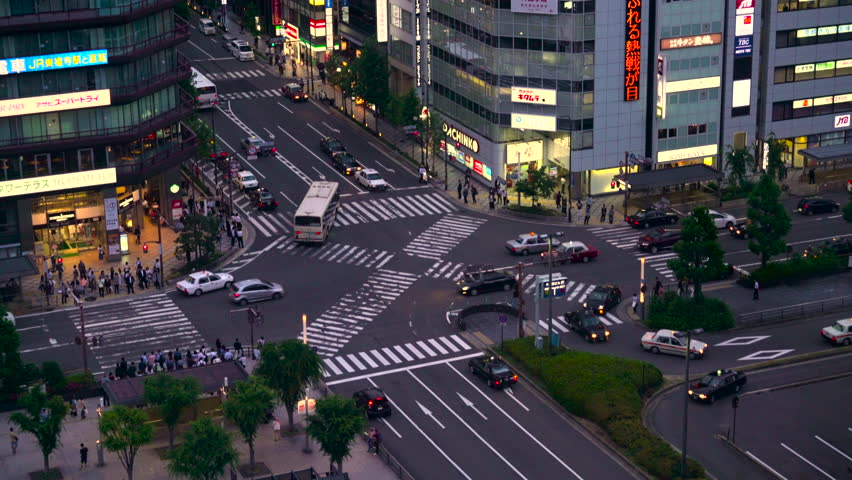 Kyoto - 25 MAY: View of people and traffic crossing the intersection outside Kyoto Tower Hotel on 25 May 2016 in Kyoto, Japan during twilight | Shutterstock HD Video #20366122