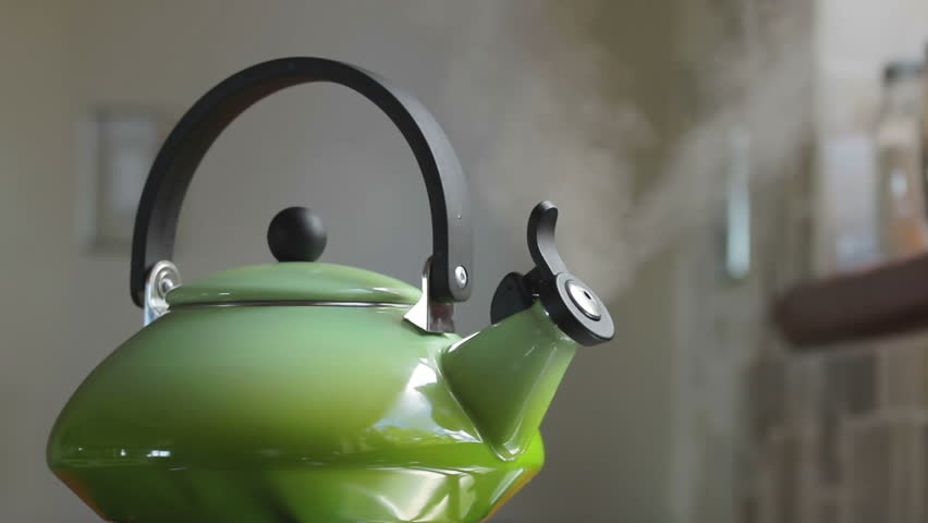 Boiling retro lime green kettle boiling with steam emitted from spout. Loop-able. Shallow DOF. Includes high quality whistling and boiling audio.