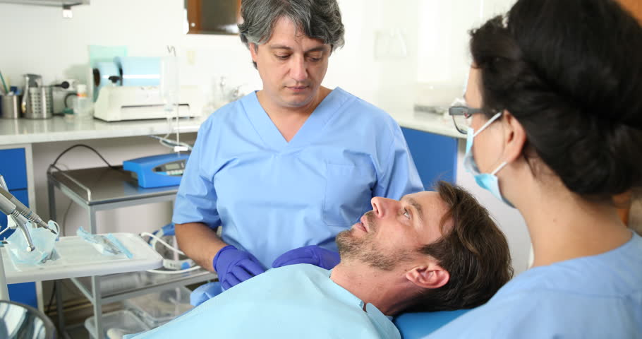 Medical Doctor Dentist Man Dialogue Patient Lying Explaining Stomatology Center. Ultra High Definition, UltraHD, Ultra HD, UHD, 4K, 2160P, 4096x2160   Shutterstock HD Video #20382502