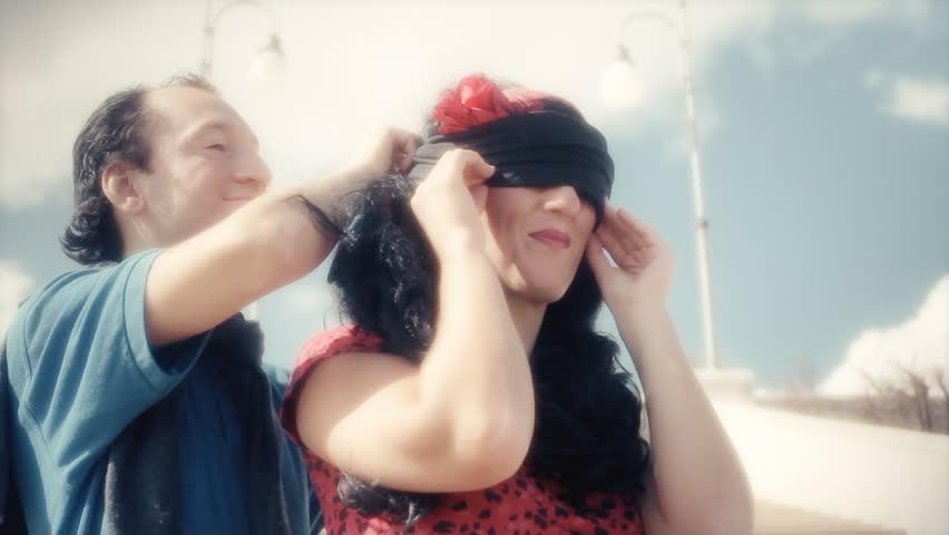 putting on the blindfold for revenge