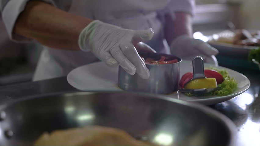 Restaurant Kitchen Video chef prepares a dish in a restaurant kitchen stock footage video